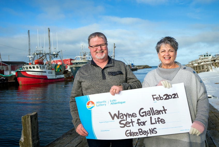 Wayne Gallant and his wife, Lois, are all smiles as they collect their winnings from an Atlantic Lottery Set for Life Scratchn'Win lottery ticket.  - CONTRIBUTED