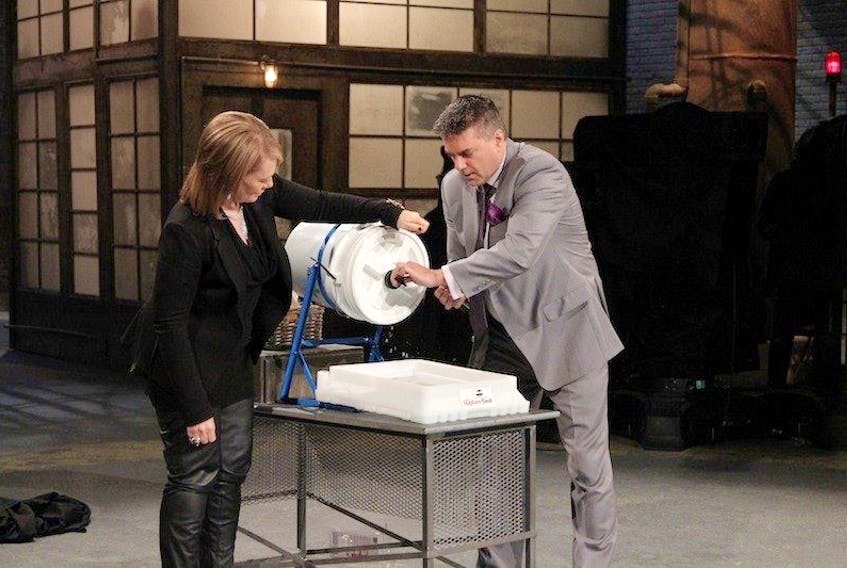 <span>Island entrepreneur Glenn Cox demonstrates his invention the RuptureSeal to Dragon Arlene Dickinson during his appearance on Dragons' Den on CBC television Nov. 5.<br /></span>