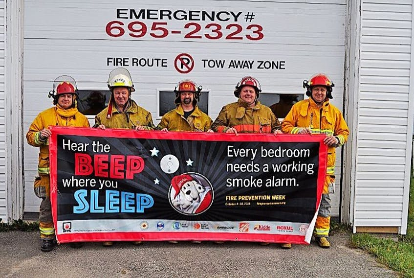 """Oct. 4-10 is fire prevention week in the province and this year's theme is """"Hear the beep where you sleep."""" Firefighters John Collier, chief Jerry Musseau, Mark Andrews, Todd Strickland and Colin Leamon gathered at the fire hall on Sept. 30."""