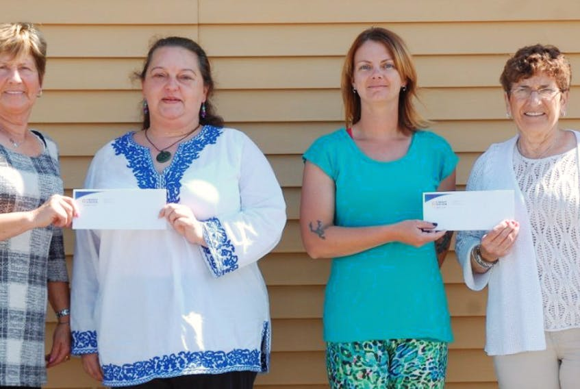 When Mary MacIsaac passed away on March 4, the family had asked in lieu of flowers donations could be made to the Leading Edge Credit Union in aid of the Codroy Valley Recreation Association and Scaredy Cat Rescue. On Aug. 3 two of Mary's daughters presented the organizations with $1,220 each. From left, Sharon King, Kat Findlay, Chantelle MacIsaac and Geraldine Hewlin.