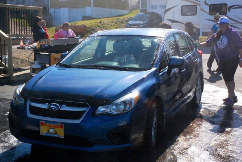 Lots of cars got a bath Oct. 1, as City Chrysler hosted a charity car wash.