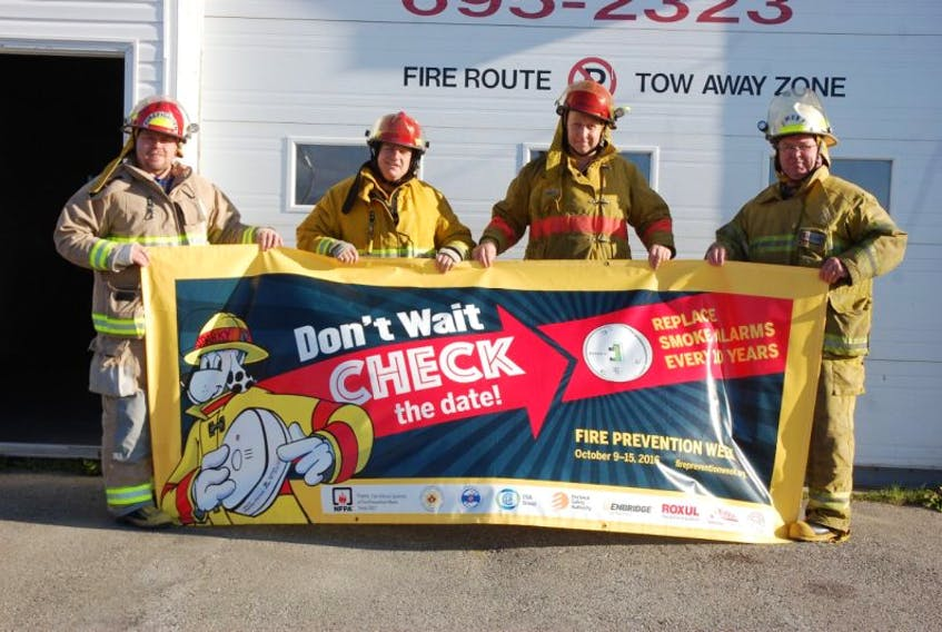 Chief Jerry Musseau, right, and members of the Port aux Basques Fire Department are reminding the public that Oct. 9-15 is Fire Prevention Week in Newfoundland and Labrador.