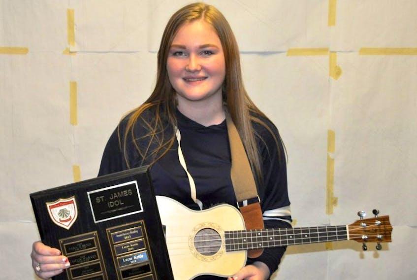 St. James Idol Season 11 winner Ocieanna Blackmore poses with her winner's plaque and ukulele.