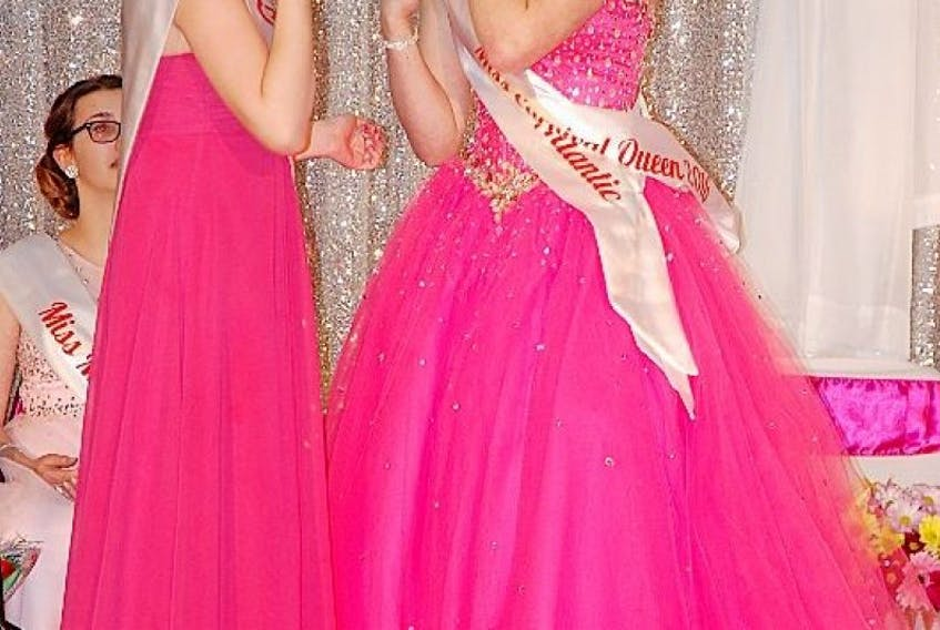 Toni Bobbett, right, said it was like a dream when she was named the 2016 Winter Carnival queen on March 11. She accepted her tiara and sash from last year's queen, Alaina Gillam.