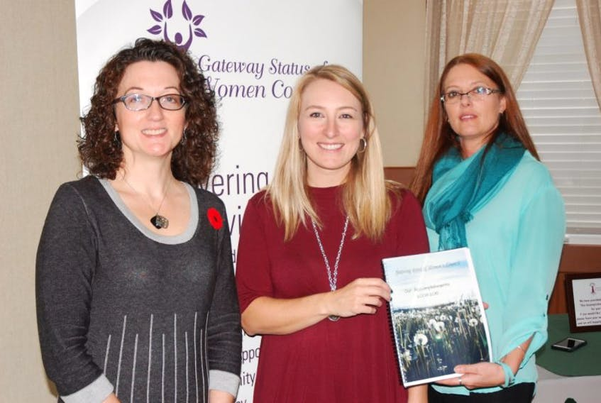 The Gateway Status of Women Council launched a new book covering the history of the council from 2008 to 2015. Sherry Bragg, right, was responsible for putting the book together. With Bragg are council president Carol Ingram, left, and executive director Tanya Hawco.