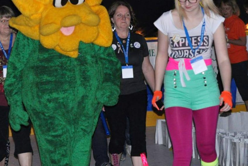 Toni Bobbett walked the track with the daffodil from the Canadian Cancer Society at last year's Relay for Life. This year's event will be held June 18.