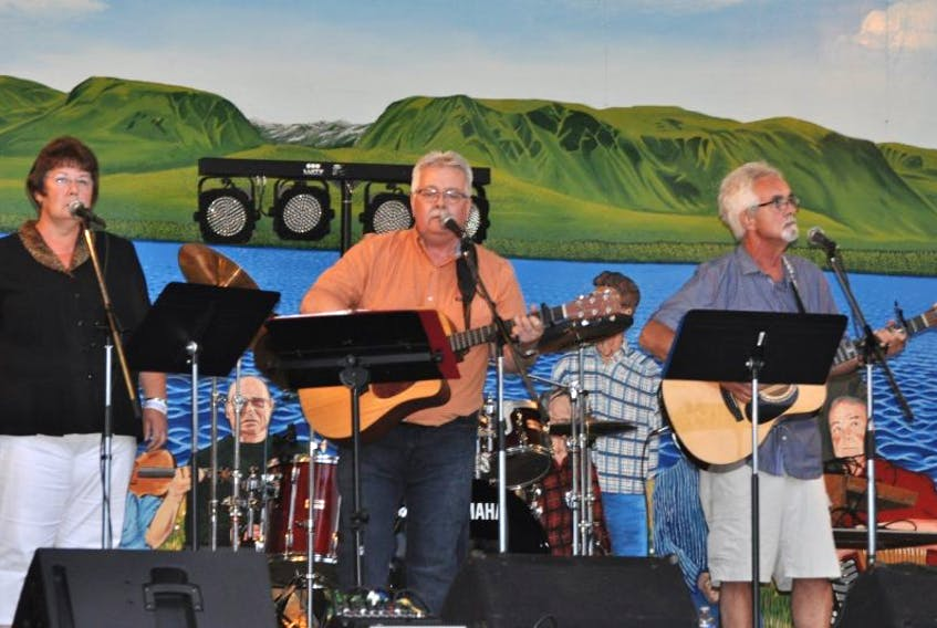 Judy Kendell, Dennis Kendell and Junior Kendell performed Friday night for the Kendall family jam.