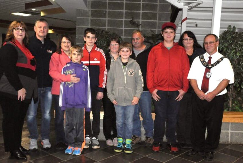 """<span class=""""Cutline"""">The families of three boys who were acknowledged for a selfless act met at the Conception Bay Regional Community Centre in Carbonear last month to announce to the boys they would be attending a student humanitarian event in Halifax. They were, from left, Jacqui Dupont (Telus representative), Ken Griffin, Karen Griffin, Jacob Griffin, Josh Griffin, Jennifer Griffin, Anthony Griffin, Paul Griffin, Andrew Green, Sheila Green and Mayor Sam Slade.</span>"""