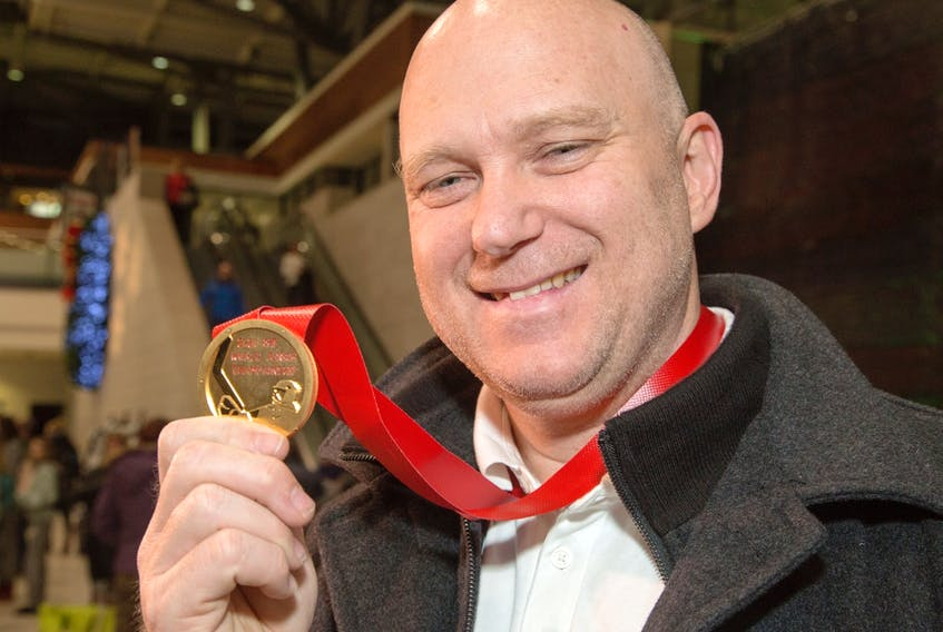 Following a long flight Team Canada assistant coach and Ottawa 67's head coach André Tourigny shows off the gold medal upon arriving at the Ottawa Airport. Canada beat Team Russia 4-3 at the world junior championships in the Czech Republic on Jan. 5, 2020.