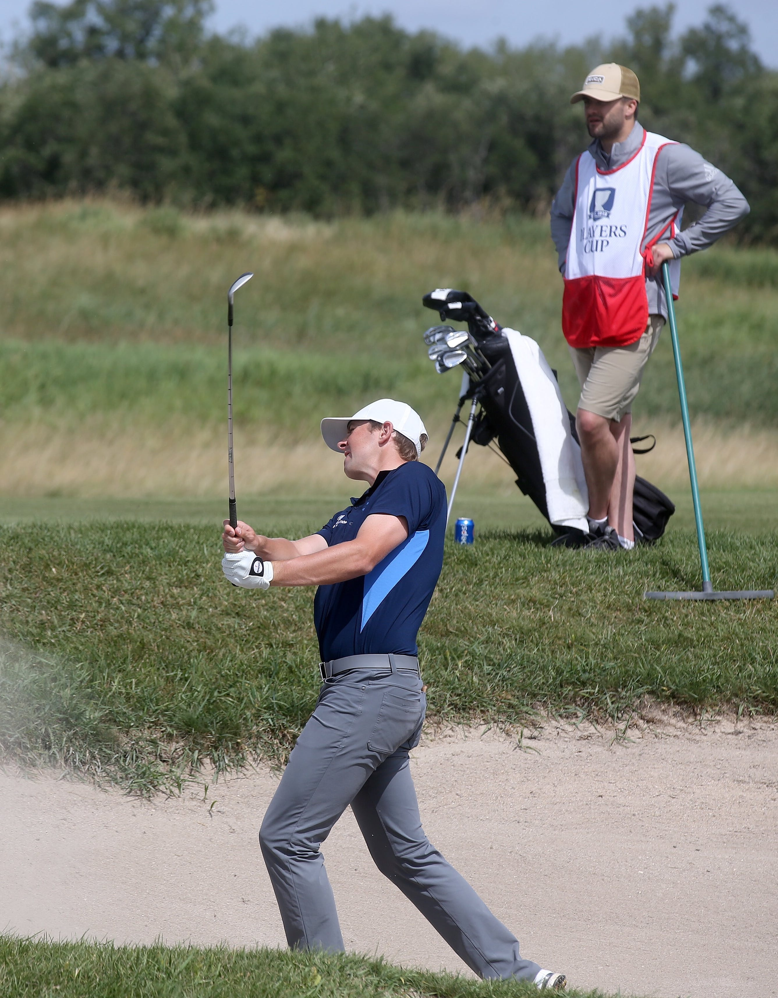 Myles Creighton hits out of a bunker while his caddy looks on during the second round of the Jacksonville Championship, Sept. 24 in Jacksonville, Fla.  PGA TOUR