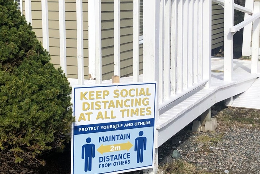 Signs like this one outside the clubhouse can be found throughout the course at The Willows as social distancing is mandated for players — Submitted
