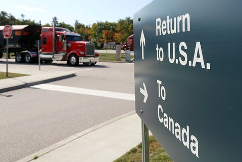 A truck leaves the Canada-United States border crossing at the Thousand Islands Bridge in Lansdowne, Ont. REUTERS File