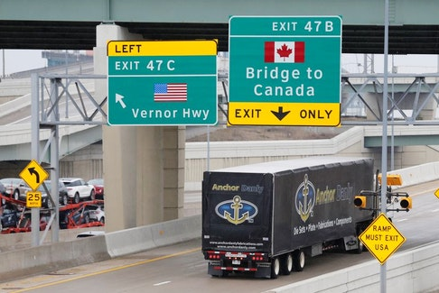 A commercial truck heads for the Ambassador Bridge at the international border crossing, which connects with Windsor, Ont., in Detroit, Michigan, U.S. REUTERS File