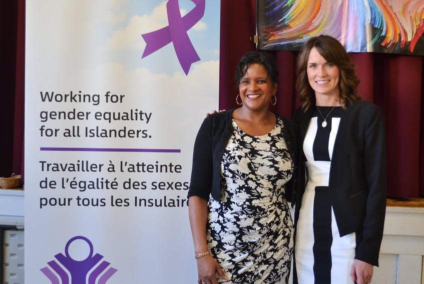 Debbie Langston, left, chairperson for the P.E.I. Advisory Council on the Status of Women and Education Minister Natalie Jameson, minister responsible for the status of women, take part in an event for International Women's Day in 2020.