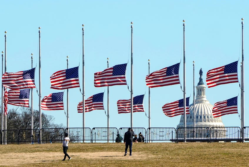 People walk past flags flying at half staff at the Washington Monument in memory of 500,000 deaths due to coronavirus disease (COVID-19) in Washington Wednesday. —  REUTERS/Joshua Roberts