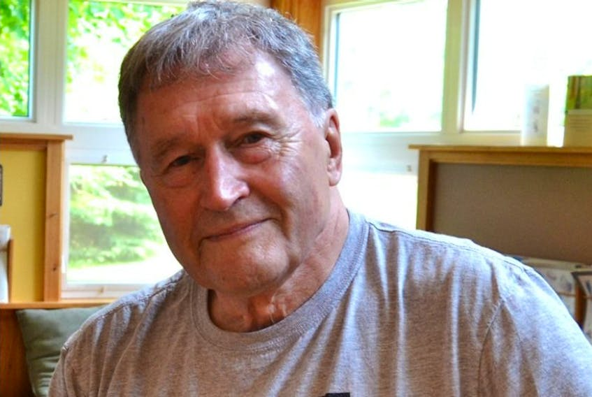Much-loved music promoter Hal Mills, seen in this July file photo, died at his home in Breadalbane on Tuesday morning.