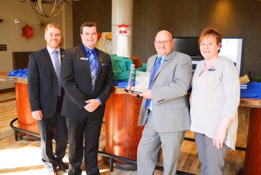 Sydney's Hampton Inn has been recognized as one of the chain's elite hotels. Staff and guests gathered at the Membertou hotel on Tuesday to celebrate the Lighthouse Award it garnered as one of Hampton's top-ranked hotels. From left, Robert MacNeil (client services manager); Rob Matheson (sales manager); Glen Morrison, hotel general manager; and Judy MacDonald (rooms division manager).
