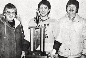 Troy Benedict, a Valley Jets forward, received the 1986 Gerald Davis Memorial Trophy. Presenting the trophy were Mary and Earl Davis.