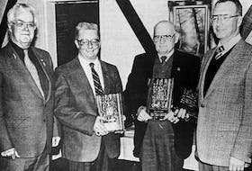 Three former Windsor councillors were honoured for their contribution to the town in 1986. Mayor Earle Hood presented plaques to former deputy mayor Stewart Johnson and former councillors Pete DeMont and Lloyd Norman.