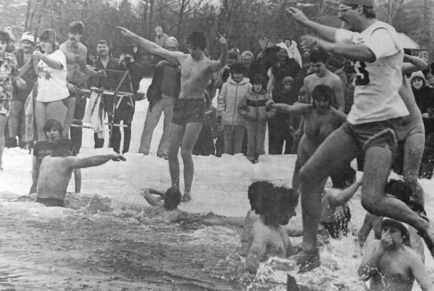 Dozens of people braved the icy waters of Zwicker Lake in 1986.
