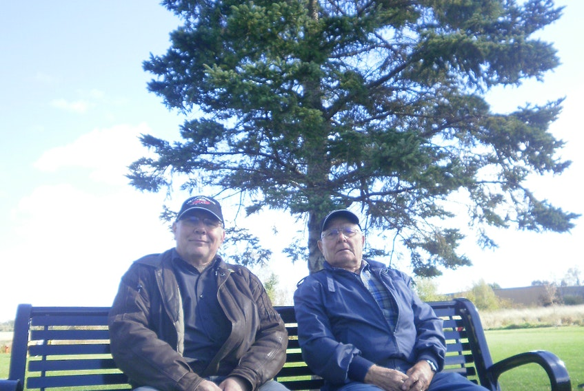 Lewis and Harold Benedict take a brief timeout to enjoy the scenery in Port Williams. - Contributed
