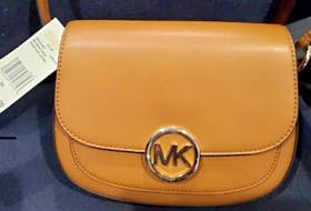 This is lot #44 in the Helping Handbags online auction, donated by Exit Realty Town and Country Real Estate. CONTRIBUTED