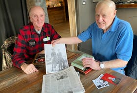 Sam Moses and Fred LeBlanc, who served together in the military in the 1950s, recently reconnected for the first time in decades after Moses read a story about LeBlanc in The Southwest Wire publication. In photo Fred holds a photograph of a younger version of the two. TINA COMEAU PHOTO