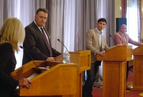 Mike Savage, Max Taylor and Matt Whitman look on as moderator Norma Lee McLeod asks a question during the mayoral debate in Halifax on Wednesday, Sept. 16. TIM KROCHAK PHOTO