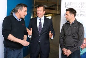 From left, David Roberts, the production director at Sustainable Fish Farming Ltd., Kings Hants MP Scott Brison, and Kirk Havercroft, the company's CEO, chat following a federal funding announcement April 21.