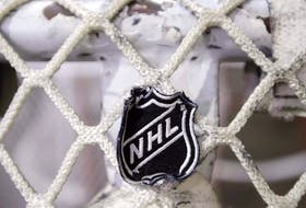 The NHL logo is seen on a goal at a Nashville Predators practice rink in Nashville, Tenn.