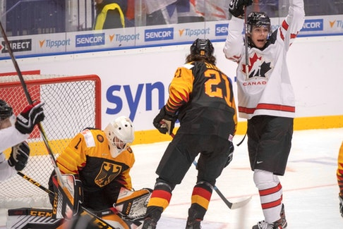 Canada's Raphael Lavoie reacts after the third goal as Germany's goaltender Hendrik Hane and Moritz Seider (21) look on during second period action at the World Junior Hockey Championships on Monday, December 30, 2019 in Ostrava, Czech Republic.