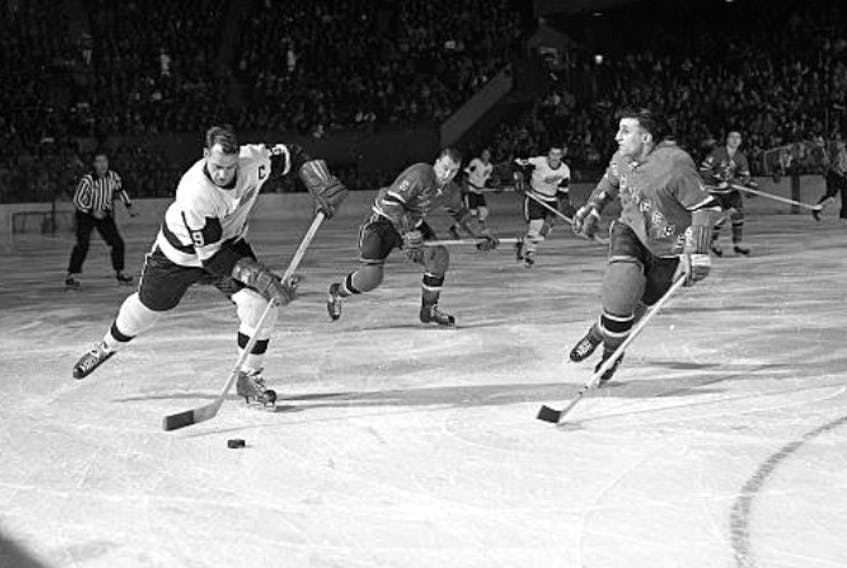The Legendary Gordie Howe, left, streaks down the ice as Sydney's John (Junior) Hanna, of the New York Rangers, prepares to angle him toward the boards. This photo appeared in the New York Times around 1959. Its caption indicated that Hanna was successful in denying Mr. Hockey a scoring opportunity on that particular play at Madison Square Garden in New York. CONTRIBUTED
