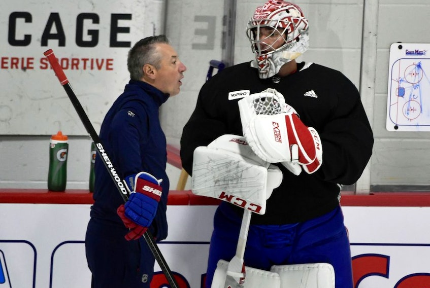 Montreal Canadiens goalie coach Stéphane Waite talks with Montreal Canadiens goalie Carey Price during a workout at the Bell Sports Complex in Brossard on July 21, 2020.