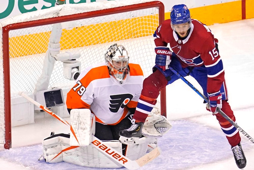 Canadiens centre Jesperi Kotkaniemi tries to set a screen in front of Flyers goalie Carter Hart during third-period   action Tuesday at the Scotiabank Arena in Toronto.