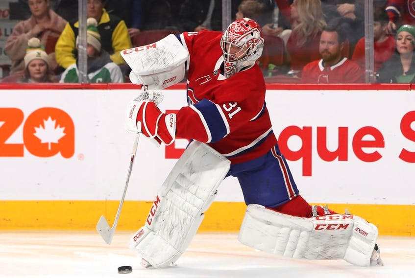 Canadiens goaltender Carey Price clears the puck against the Dallas Stars at the Bell Centre on Feb. 15, 2020, in Montreal.