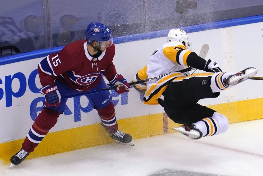Canadiens' Jesperi Kotkaniemi takes down Penguins defenceman Brian Dumoulin during Eastern Conference qualifications last week. The young centre was a difference-maker for Montreal in the series.