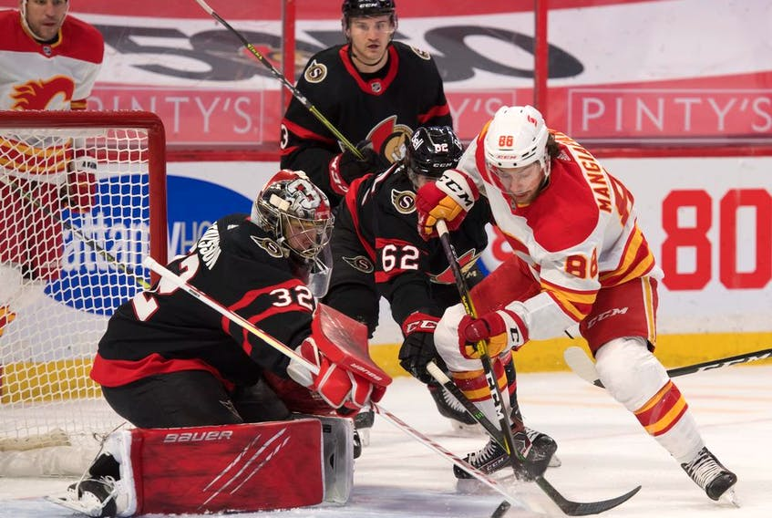 Calgary Flames left wing Andrew Mangiapane (88) moves in for a shot against Ottawa Senators goalie Filip Gustavsson (32) in the first period at the Canadian Tire Centre in Ottawa on Monday, March 22, 2021.