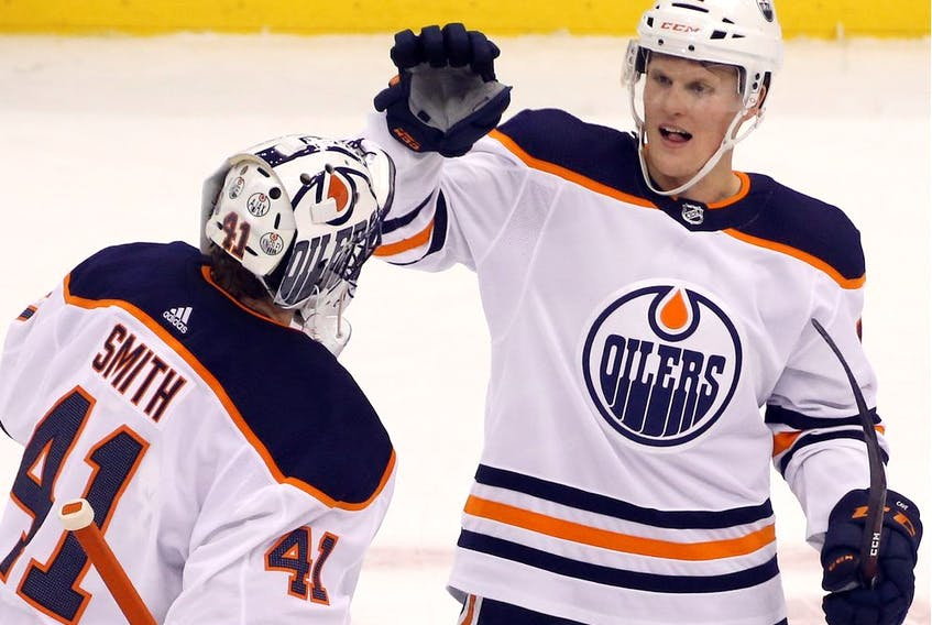 Edmonton Oilers goaltender Mike Smith (41) and centre Colby Cave (12) celebrate after defeating the Pittsburgh Penguins at PPG PAINTS Arena. The Oilers won 2-1 in overtime.