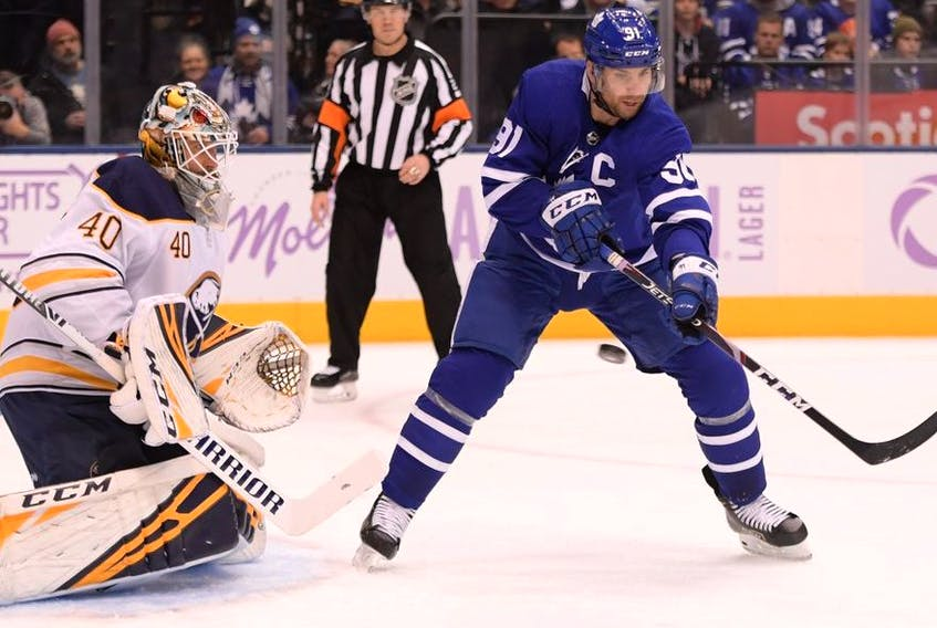 Toronto Maple Leafs forward John Tavares deflects the puck as Buffalo Sabres goalie Carter Hutton defends in the second period at Scotiabank Arena.
