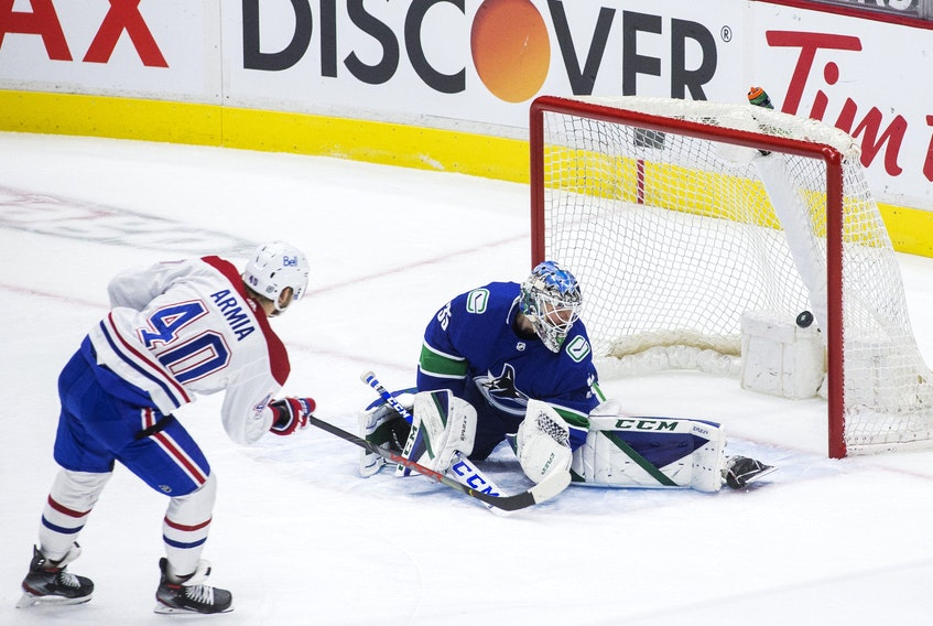 Montreal Canadiens forward Joel Armia scores on Vancouver Canucks goalie Thatcher Demko in first-period action in Vancouver on Jan. 21, 2021.