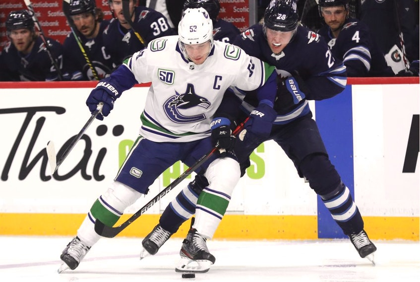 Jets' winger Patrik Laine ties up Bo Horvat of the Vancouver Canucks during Friday's NHL action at Bell MTS Place in Winnipeg. The Canucks wrapped up a quick two-game road trip with a loss in the Manitoba capital.