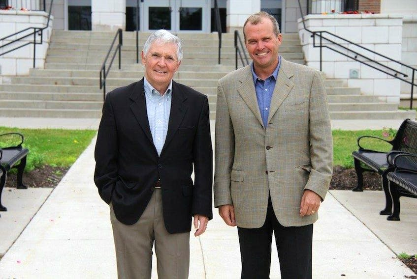 <span>Holland College Board of Governors vice chairman Michael O'Brien, left, and incoming chairman Kent Scales stand outside the Prince of Wales campus in Charlottetown recently </span>
