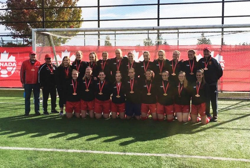 Members of the Holy Cross Avalon Ford soccer team pose with the bronze medals they won at the Jubilee Trophy national tournament in Surrey, B.C., on Monday. It's the first-ever medal finish by a Newfoundland and Labrador team at a Canadian senior women's soccer championship.