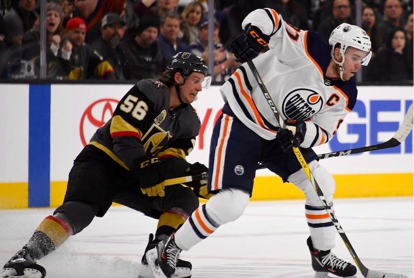 Edmonton Oilers captain Connor McDavid skates against Erik Haula of the Vegas Golden Knights at T-Mobile Arena on Jan. 13, 2018, in Las Vegas. The Oilers won 3-2 in overtime.