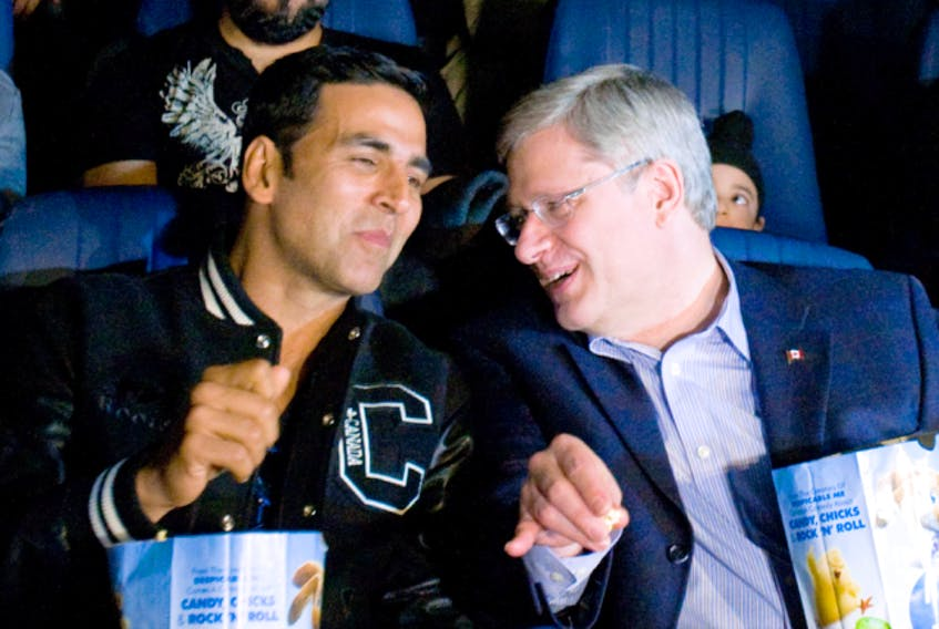 Bollywood actor Akshay Kumar at Toronto movie theatre with then-prime minister Stephen Harper on April 8, 2011.