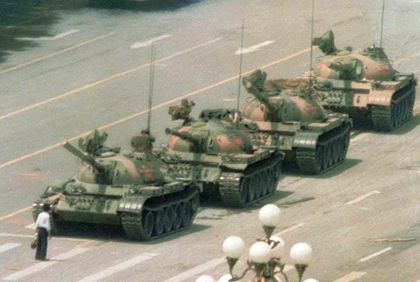 In this now-iconic June 5, 1989 file photo, a man stands alone to block a line of tanks heading east on Beijing's Changan Blvd. from Tiananmen Square in Beijing.