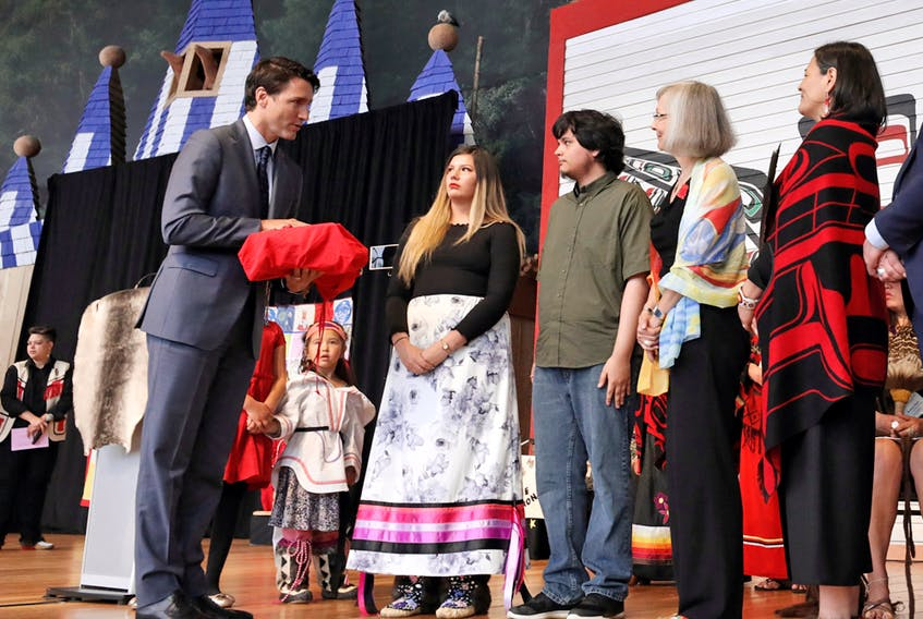 Prime Minister Justin Trudeau is presented with the final report during the closing ceremony of the National Inquiry into Missing and Murdered Indigenous Women and Girls in Gatineau, Que., on June 3.