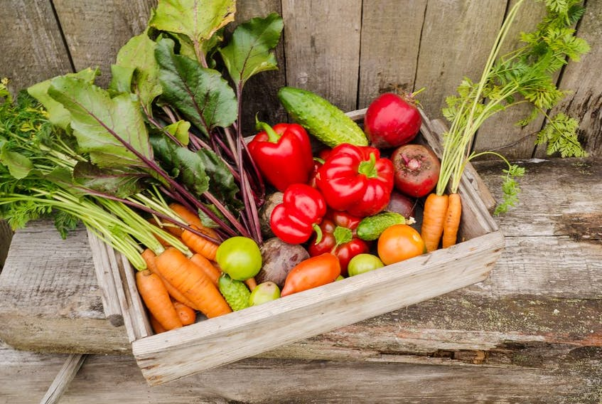 Growing veggies in containers is less work because you don't have a vast plot of land to weed and water.