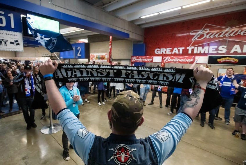 Vancouver Whitecaps fans gather on the stadium concourse after leaving their seats during an in-game walkout on April 27. The protests will continue after a meeting with ownership failed to bring any resolution to the crisis.
