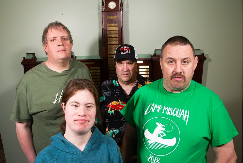 (Clockwise from lower left) Suzanne Winter-Heartson, 32, Brian Jones, 48, Scott Helman, 50, and Paul Pringle, 45, are four of 33 workers with developmental disabilities who have been told their contract shredding paper for the federal government will end next year. It's the second time the program, run by the Ottawa-Carleton Association for Persons with Developmental Disabilities, has faced elimination. Some of the workers have been employed on the job for decades.